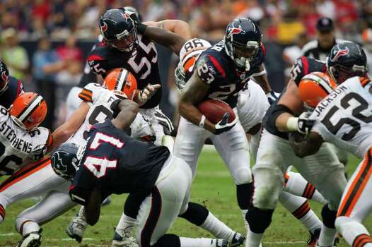 Houston Texans running back Arian Foster (23) breaks free from a crowd on a 19-yard touchdown run against the Cleveland Browns during the second quarter of an NFL football game at Reliant Stadium on Sunday, Nov. 6, 2011, in Houston. Photo: Smiley N. Pool, Houston Chronicle / © 2011  Houston Chronicle