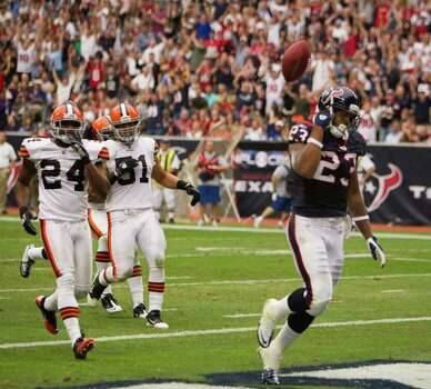 Houston Texans running back Arian Foster (23) tosses the ball over his head after scoring on a 19-yard touchdown run against the Cleveland Brownsduring the second quarter of an NFL football game at Reliant Stadium on Sunday, Nov. 6, 2011, in Houston. Photo: Smiley N. Pool, Houston Chronicle / © 2011  Houston Chronicle