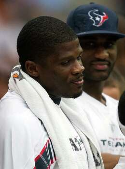 Houston Texans wide receiver Andre Johnson watches from the sidelines against the Cleveland Browns during the second quarter of an NFL football game at Reliant Stadium on Sunday, Nov. 6, 2011, in Houston. Photo: Smiley N. Pool, Houston Chronicle / © 2011  Houston Chronicle