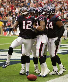 Houston Texans running back Arian Foster (23) celebrates with wide receiver Jacoby Jones (12) and guard Wade Smith (74) after scoring on a 19-yard touchdown run against the Cleveland Brownsduring the second quarter of an NFL football game at Reliant Stadium on Sunday, Nov. 6, 2011, in Houston. Photo: Smiley N. Pool, Houston Chronicle / © 2011  Houston Chronicle
