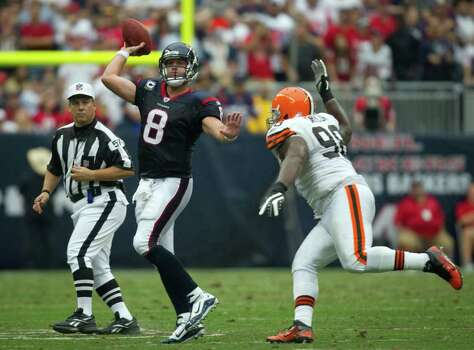 Houston Texans quarterback Matt Schaub (8) tosses a pass over Cleveland Browns defensive tackle Phillip Taylor (98) during the third quarter of an NFL football game at Reliant Stadium on Sunday, Nov. 6, 2011, in Houston. Photo: Smiley N. Pool, Houston Chronicle / © 2011  Houston Chronicle