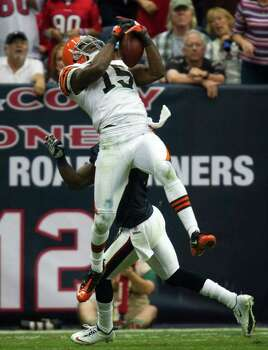 Cleveland Browns wide receiver Greg Little (15) catches a pass over Houston Texans cornerback Kareem Jackson (25) during the third quarter of an NFL football game at Reliant Stadium on Sunday, Nov. 6, 2011, in Houston. Photo: Smiley N. Pool, Houston Chronicle / © 2011  Houston Chronicle