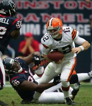 Cleveland Browns quarterback Colt McCoy (12) is brought down by Houston Texans defensive end Tim Jamison (96) during the second quarter of an NFL football game at Reliant Stadium on Sunday, Nov. 6, 2011, in Houston. Photo: Smiley N. Pool, Houston Chronicle / © 2011  Houston Chronicle