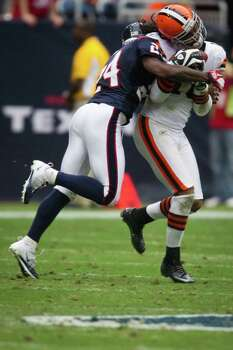 Cleveland Browns wide receiver Josh Cribbs (16) is hit hard by Houston Texans cornerback Johnathan Joseph (24) during the second quarter of an NFL football game at Reliant Stadium on Sunday, Nov. 6, 2011, in Houston. Photo: Smiley N. Pool, Houston Chronicle / © 2011  Houston Chronicle
