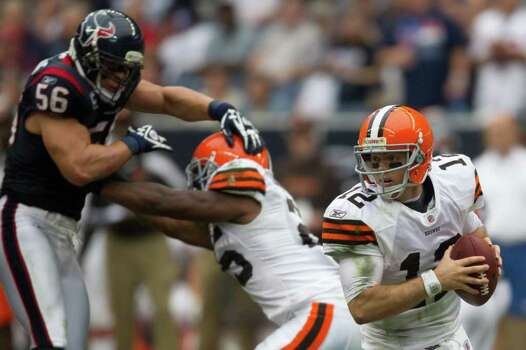 Cleveland Browns quarterback Colt McCoy (12) spins away from the rush of Houston Texans inside linebacker Brian Cushing (56) during the second quarter of an NFL football game at Reliant Stadium on Sunday, Nov. 6, 2011, in Houston. Photo: Smiley N. Pool, Houston Chronicle / © 2011  Houston Chronicle