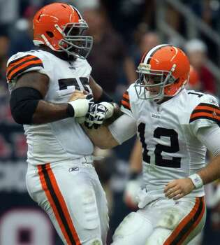 Cleveland Browns quarterback Colt McCoy (12) is helped up by tackle Artis Hicks (75) after a hard hit during the fourth quarter of an NFL football game against the Houston Texans at Reliant Stadium on Sunday, Nov. 6, 2011, in Houston. Photo: Smiley N. Pool, Houston Chronicle / © 2011  Houston Chronicle
