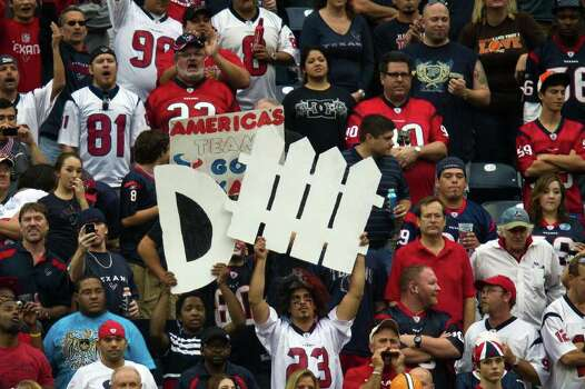 Houston Texans fans cheer their defense against the Cleveland Browns during the fourth quarter of an NFL football game at Reliant Stadium on Sunday, Nov. 6, 2011, in Houston. Photo: Smiley N. Pool, Houston Chronicle / © 2011  Houston Chronicle