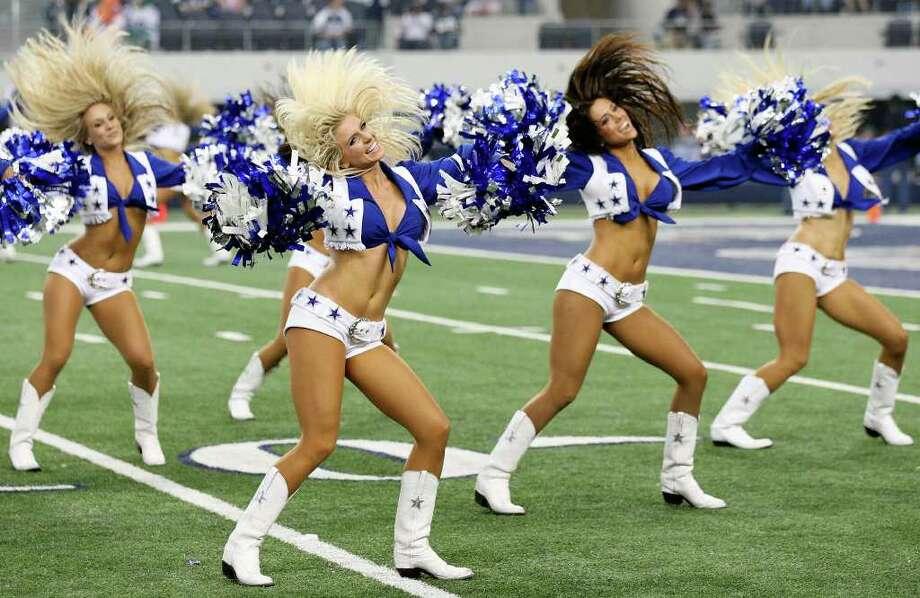Dallas Cowboys Cheerleaders perform during the Cowboys and Seahawks game Sunday Nov. 6, 2011 at Cowboys Stadium in Arlington, TX. The Cowboys won 23-13. Photo: EDWARD A. ORNELAS, Express-News / © SAN ANTONIO EXPRESS-NEWS (NFS)