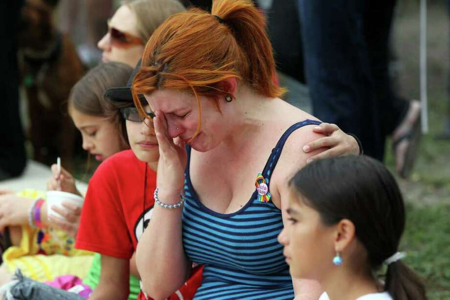 Lindsay Groff, comforted by Persephone Osander (glasses), cries at a memorial service held for Rebecca Gonzales, daughter Samvastion Ochoa and an unborn daughter at Crockett Park. Another woman, Pamela Wenske, was also killed. Photo: John Davenport / Jdavenport@express-news.net / SAN ANTONIO EXPRESS-NEWS (Photo can be sold to the public)