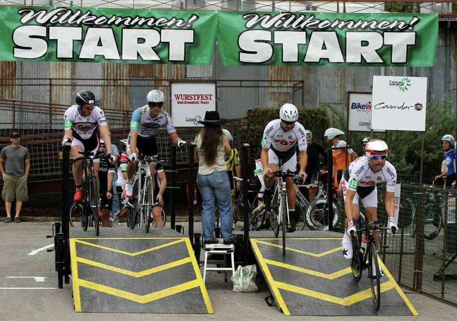 Cyclists taking part in the Two Person Team Time Trials of the Tour de Gruene start the course in Gruene, Texas Sunday November 5, 2011. Individual time trials took place on Saturday. JOHN DAVENPORT/jdavenport@express-news.net Photo: Express-News