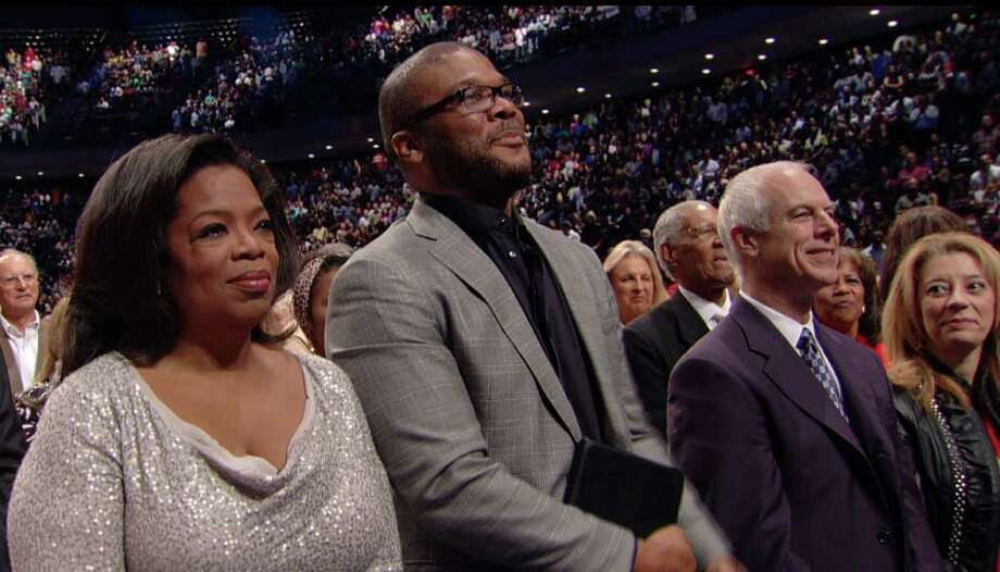 LAKEWOOD CHURCH STAR POWER: Media moguls Oprah Winfrey and Tyler Perry attend Lakewood Church Sunday. Photo: Lakewood Church / Lakewood Church