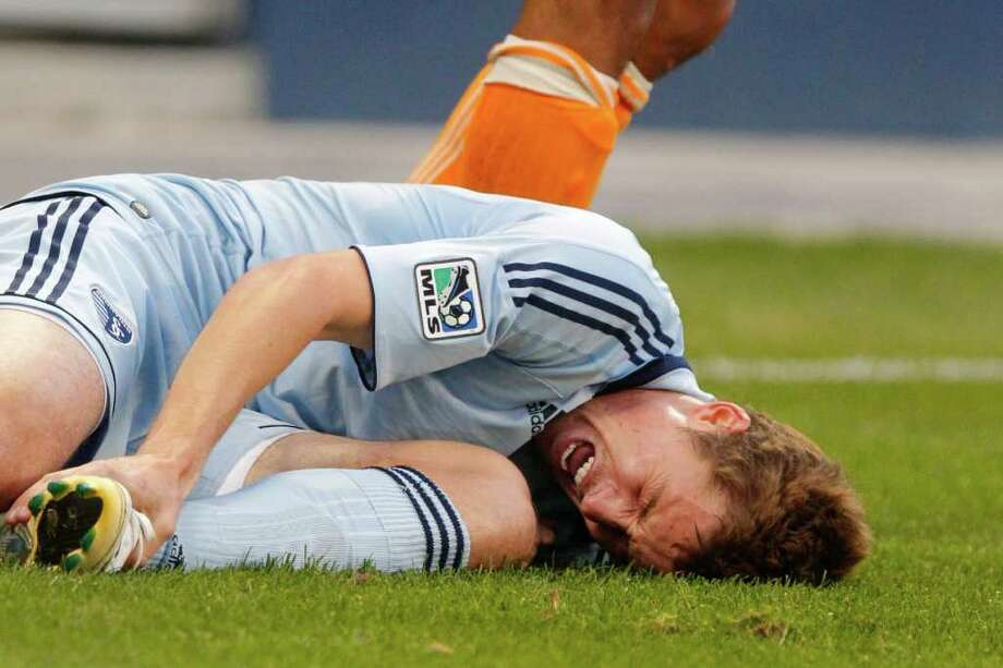 KANSAS CITY, KS - NOVEMBER 06: Chance Myers #07 of the Sporting Kansas City reacts in pain after having his foot stepped on against the Houston Dynamo in the first half during the MLS Eastern Conference Championship match at Livestrong Sporting Park on November 06, 2011 in Kansas City, Kansas. Photo: Kyle Rivas, Getty / 2011 Getty Images