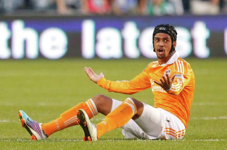 KANSAS CITY, KS - NOVEMBER 06: Calen Carr #03 of the Houston Dynamo looks towards the referee after being tripped by Sporting Kansas City in the first half during the MLS Eastern Conference Championship match at Livestrong Sporting Park on November 06, 2011 in Kansas City, Kansas. Photo: Kyle Rivas, Getty / 2011 Getty Images