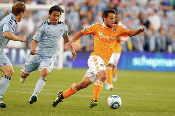 KANSAS CITY, KS - NOVEMBER 06: Danny Cruz #05 of the Houston Dynamo pushes the ball up the field in the first half during the MLS Eastern Conference Championship match at Livestrong Sporting Park on November 06, 2011 in Kansas City, Kansas.