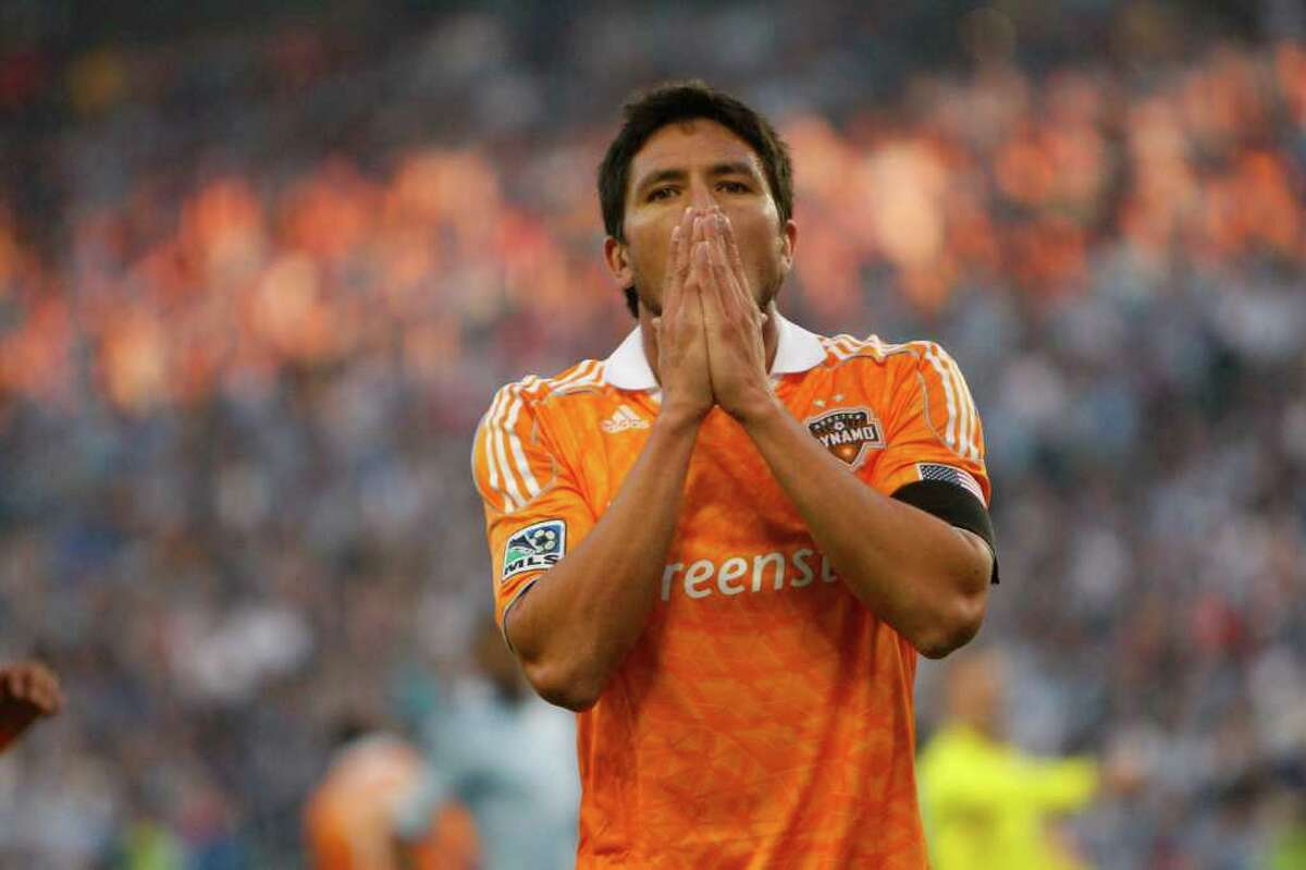 KANSAS CITY, KS - NOVEMBER 06: Brian Ching of the Houston Dynamo reacts to his shot being block by Jimmy Nielsen #1 of Sporting Kansas City in the first half during the MLS Eastern Conference Championship match at Livestrong Sporting Park on November 06, 2011 in Kansas City, Kansas.