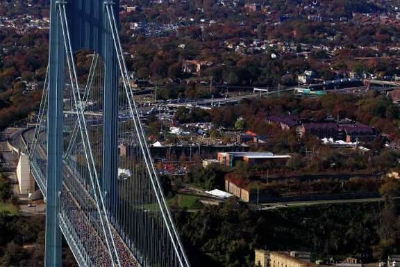 CHRIS TROTMAN: GETTY IMAGES TRAFFIC JAM: The field of more than 47,000 runners makes its way across the Verrazano-Narrows Bridge into Brooklyn.