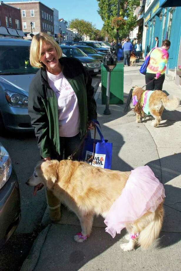 """Its was a beautiful day for the Howl & Prowl parade this past Sunday. Greenwich's Main Ave were masked dogs and their people marched around town for treats and  a chance to win prizes for the best costumes. All the money raised went to Adopt-a-Dog organization a full-service shelter to help find good homes for dogs and cats."""" Photo: Mike Spero / Hearst Connecticut / Greenwich Time"""