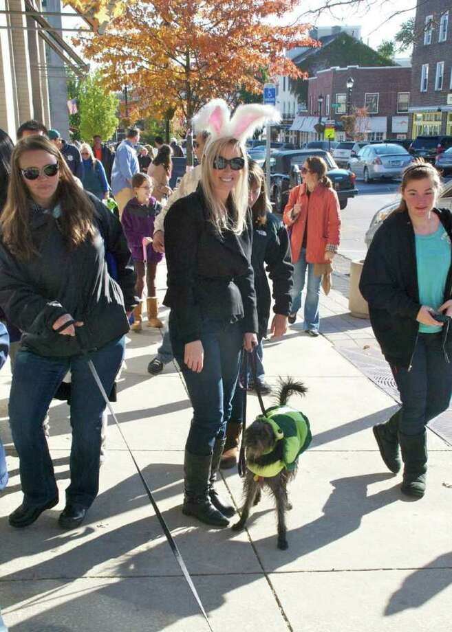 "Its was a beautiful day for the Howl & Prowl parade this past Sunday. Greenwich's Main Ave were masked dogs and their people marched around town for treats and  a chance to win prizes for the best costumes. All the money raised went to Adopt-a-Dog organization a full-service shelter to help find good homes for dogs and cats."" Photo: Mike Spero / Hearst Connecticut / Greenwich Time"