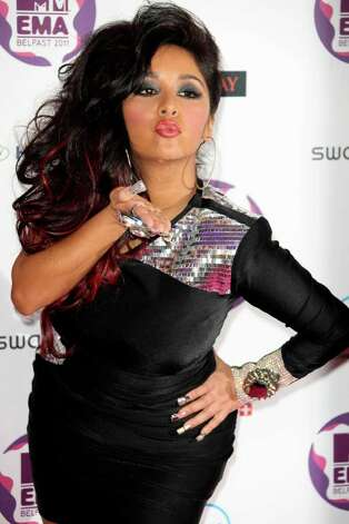 "LORENZO DOMINICNicole ""Snooki"" Polizzi and fiance Jionni LaValle became parents on Aug. 26. She'll manage motherhood along with a new line of bargain wear. Photo: Joel Ryan / AP"