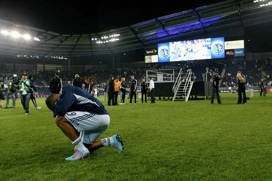 KANSAS CITY, KS - NOVEMBER 06:  Teal Bunbury #9 of the Sporting Kansas City kneels down on the field after Houston Dynamo defeating Sporting Kansas City in the MLS Eastern Conference Championship match at Livestrong Sporting Park on November 06, 2011 in Kansas City, Kansas. Photo: Kyle Rivas, Getty / 2011 Getty Images