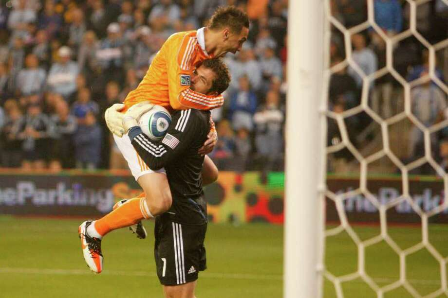KANSAS CITY, KS - NOVEMBER 06: Geoff Cameron #20 jumps onto Tally Hall #1 of the Houston Dynamo in celebration after defeating Sporting Kansas City in the MLS Eastern Conference Championship match at Livestrong Sporting Park on November 06, 2011 in Kansas City, Kansas. Photo: Kyle Rivas, Getty / 2011 Getty Images