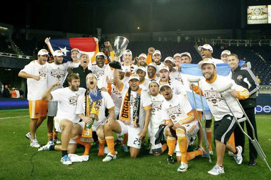 KANSAS CITY, KS - NOVEMBER 06: Members of the Houston Dynamo celebrate their victory over Sporting K