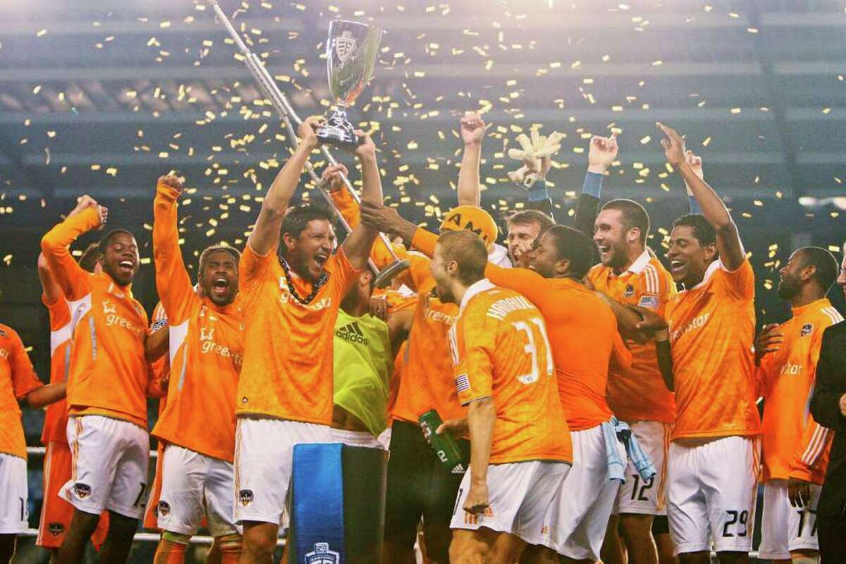 KANSAS CITY, KS - NOVEMBER 06: Members of the Houston Dynamo celebrate their victory over Sporting Kansas City after the MLS Eastern Conference Championship match at Livestrong Sporting Park on November 06, 2011 in Kansas City, Kansas.