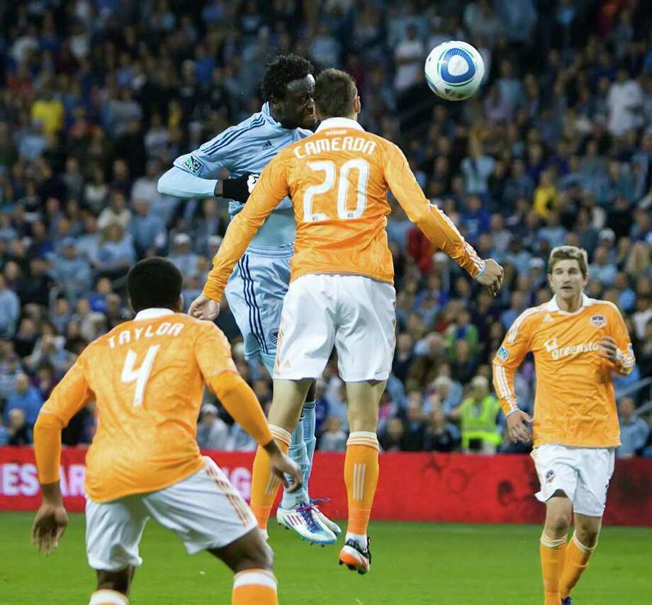Sporting KC forward Kei Kamara (23) headed the ball toward the goal as Houston Dynamo midfielder Geoff Cameron (20) defended in the second half of their Major League Soccer Eastern Conference Final game. Houston beat Kansas City, 2-0, at Livestrong Park on Sunday, November 6, 2011, in Kansas City, Kansas. City, Kansas. (Shane Keyser/Kansas City Star/MCT) Photo: Shane Keyser, McClatchy-Tribune News Service / Kansas City Star