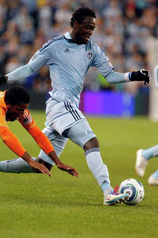 KANSAS CITY, KS - NOVEMBER 06:  Kei Kamara #23 of the Sporting Kansas City drives past Jermaine Taylor #4 the Houston Dynamo in the second half during the MLS Eastern Conference Championship match at Livestrong Sporting Park on November 06, 2011 in Kansas City, Kansas. Photo: Kyle Rivas, Getty / 2011 Getty Images