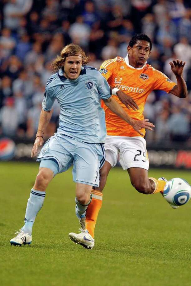 KANSAS CITY, KS - NOVEMBER 06:  Chance Myers #07 of the Sporting Kansas City pushes off Carlo Costly #29 Houston Dynamo in the second half during the MLS Eastern Conference Championship match at Livestrong Sporting Park on November 06, 2011 in Kansas City, Kansas. Photo: Kyle Rivas, Getty / 2011 Getty Images