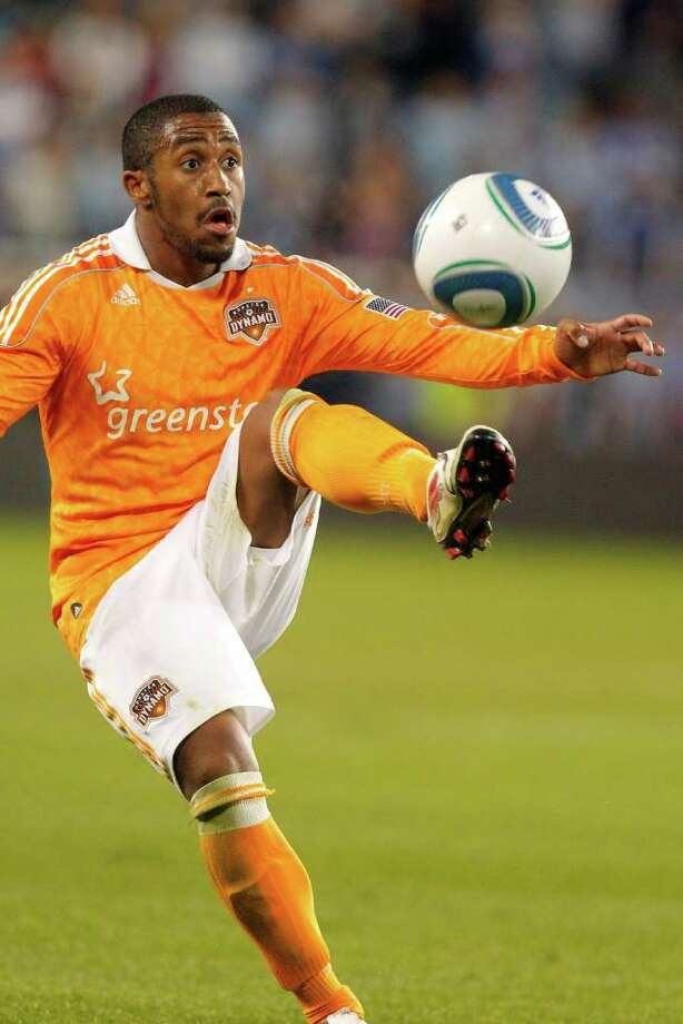 KANSAS CITY, KS - NOVEMBER 06:  Corey Ashe #26 of the Houston Dynamo gains control of a lose ball against Sporting Kansas City in the second half during the MLS Eastern Conference Championship match at Livestrong Sporting Park on November 06, 2011 in Kansas City, Kansas. Photo: Kyle Rivas, Getty / 2011 Getty Images