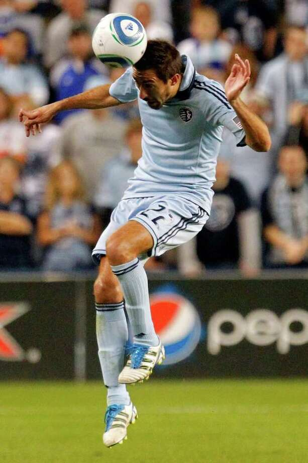 KANSAS CITY, KS - NOVEMBER 06:  Davy Arnaud #22 of the Sporting Kansas City heads the ball against the Houston Dynamo in the second half during the MLS Eastern Conference Championship match at Livestrong Sporting Park on November 06, 2011 in Kansas City, Kansas. Photo: Kyle Rivas, Getty / 2011 Getty Images