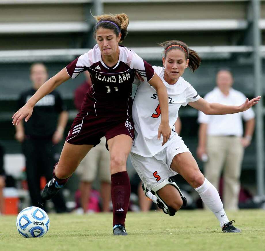 Texas A&M Bri Young husltes for ball control against Oklahoma State University Kyndall Treadwell in the 2011 Big 12 Soccer Championship game at Blossom Soccer Stadium, Sunday, Nov. 6, 2011. A&M won 1-0 in a last second goal. JERRY LARA/glara@express-news.net Photo: JERRY LARA, Express-News / SAN ANTONIO EXPRESS-NEWS