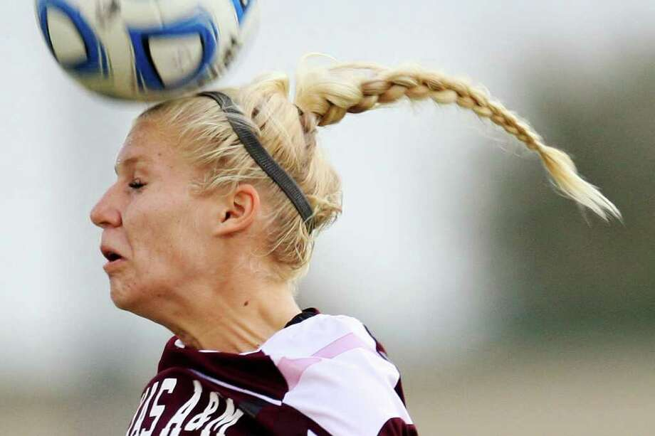 Texas A&M Rachel Lenz hits the ball against Oklahoma State University in the 2011 Big 12 Soccer Championship game at Blossom Soccer Stadium, Sunday, Nov. 6, 2011. A&M won 1-0 in a last second goal. JERRY LARA/glara@express-news.net Photo: JERRY LARA, Express-News / SAN ANTONIO EXPRESS-NEWS
