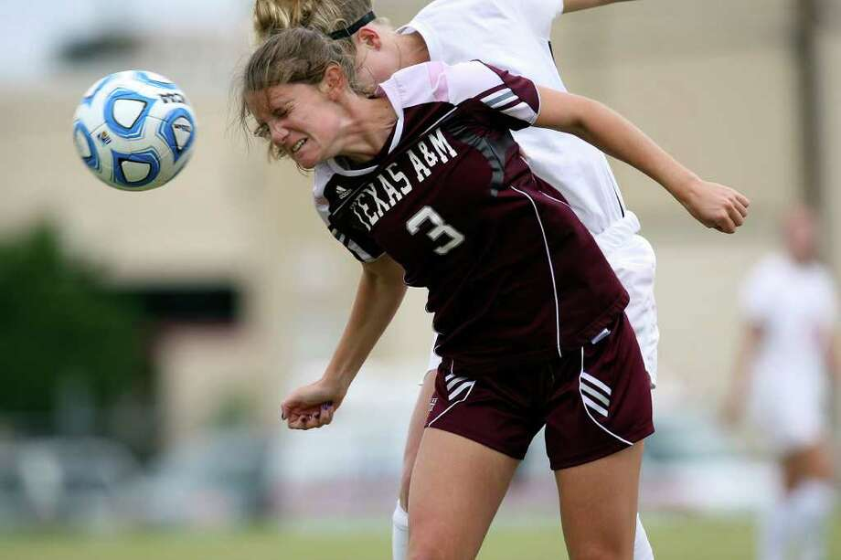 Texas A&M Katie Hamilton tries to control the ball under pressure from Oklahoma State University Colleen Dougherty in the 2011 Big 12 Soccer Championship game at Blossom Soccer Stadium, Sunday, Nov. 6, 2011. A&M won 1-0 in a last second goal. JERRY LARA/glara@express-news.net Photo: JERRY LARA, Express-News / SAN ANTONIO EXPRESS-NEWS