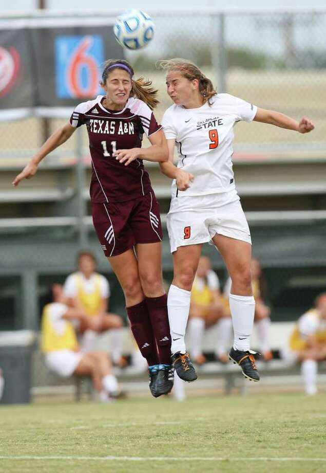 Texas A&M Bri Young squares off with Oklahoma State University Annika Niemeier in the 2011 Big 12 Soccer Championship game at Blossom Soccer Stadium, Sunday, Nov. 6, 2011. A&M won 1-0 in a last second goal. JERRY LARA/glara@express-news.net Photo: JERRY LARA, Express-News / SAN ANTONIO EXPRESS-NEWS