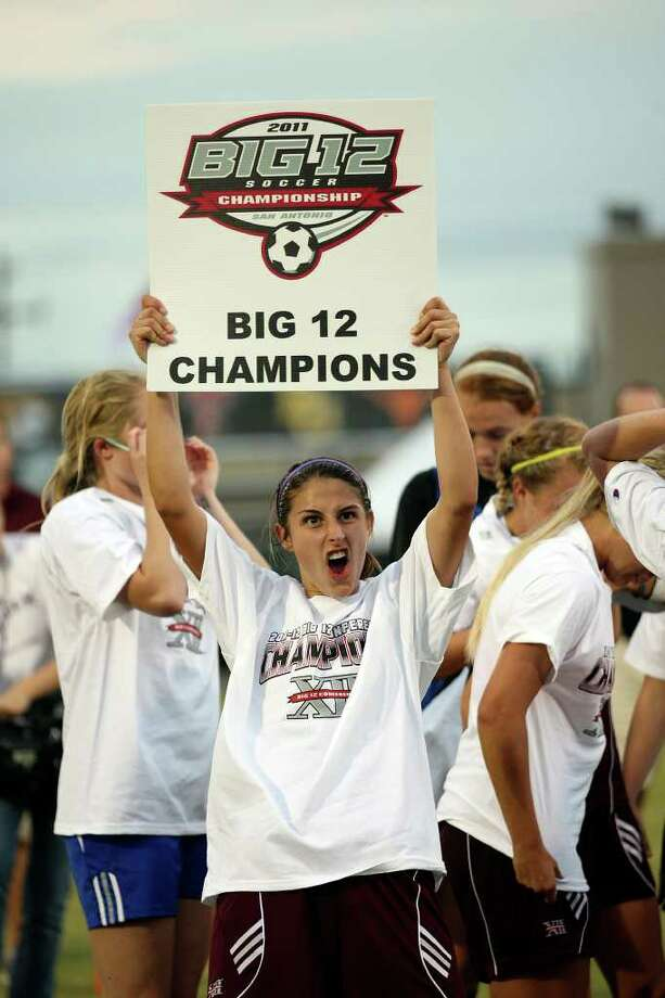 Texas A&M's Bri Young celebrates their victory over Oklahoma State University to win the 2011 Big 12 Soccer Championship at Blossom Soccer Stadium, Sunday, Nov. 6, 2011. A&M won 1-0 in a last second goal. JERRY LARA/glara@express-news.net Photo: JERRY LARA, Express-News / SAN ANTONIO EXPRESS-NEWS