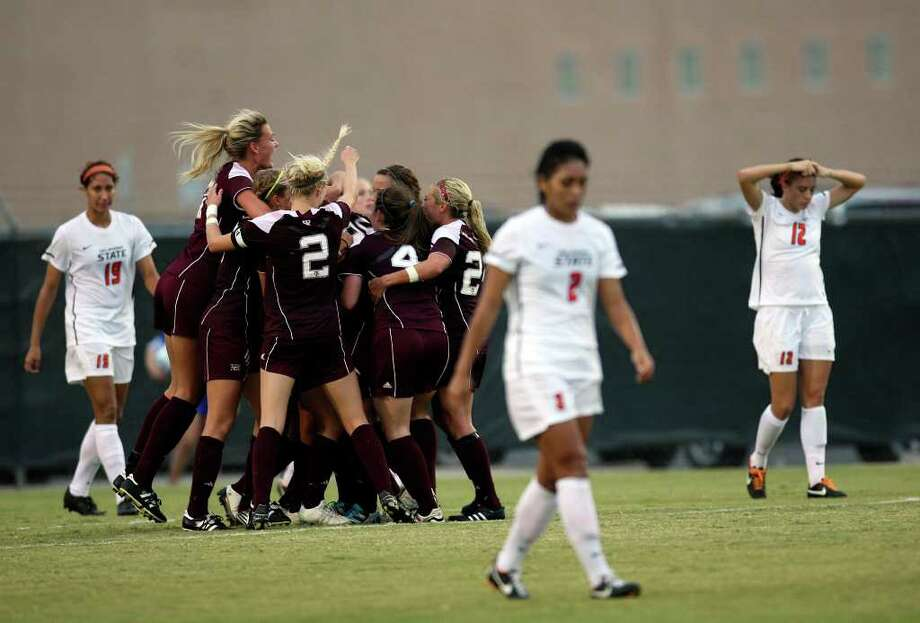 Texas A&M celebrates their last second goal against Oklahoma State University to win the 2011 Big 12 Soccer Championship at Blossom Soccer Stadium, Sunday, Nov. 6, 2011. A&M won 1-0 and scored with nine seconds left in the game. JERRY LARA/glara@express-news.net Photo: JERRY LARA, Express-News / SAN ANTONIO EXPRESS-NEWS
