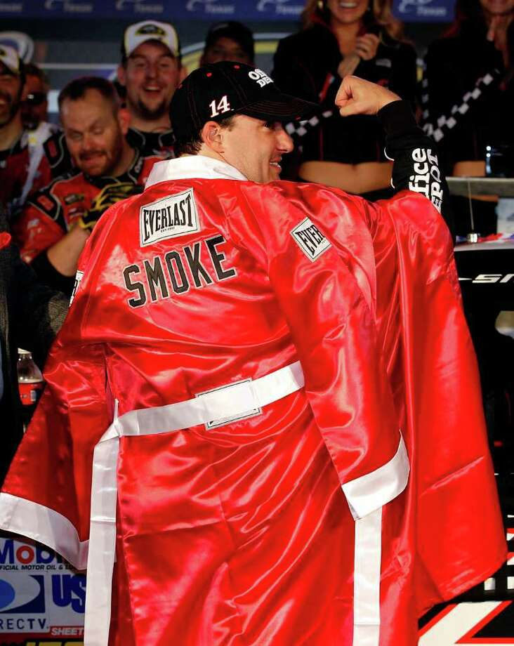 """STATE CHAMP: Tony Stewart dons his boxing robe after scoring a decision over Carl Edwards in the """"Texas Title Fight."""" Photo: Chris Graythen / 2011 Getty Images"""
