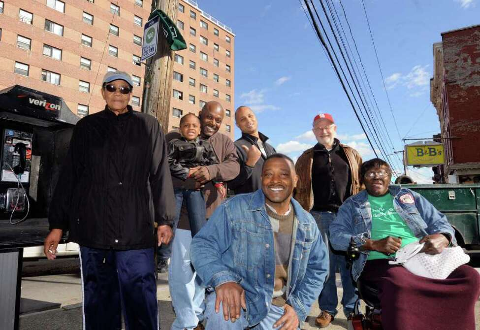 Willie White,center, executive director of AVillage Inc., and other members of a grass-roots community group that pushed CDTA for 20 years to get bus service up Morton Avenue. They're having a street party Nov. 13 before the first run of the bus to celebrate the people's victory. New bus shelters are expected to be built at this corner, but work has not started yet in Albany, NY Friday, Nov.4, 2011. Also pictured Clara Phillips, Sam Coleman with 3-year-old son Xavier Coleman, Lester Freeman Tom McPheeters and Bessie E. Thompson.( Michael P. Farrell/Times Union)