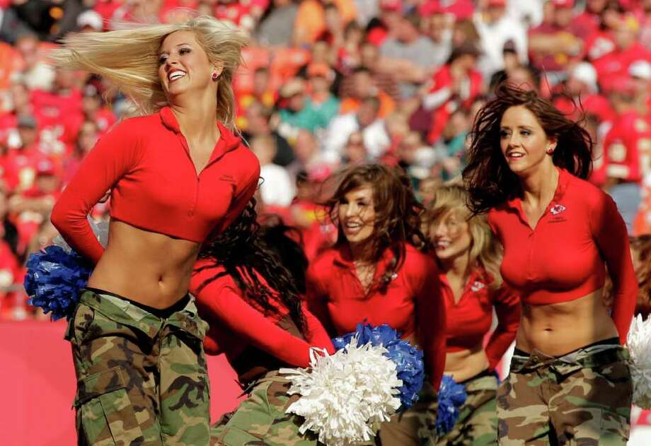 Wearing camouflage for military appreciation day, Kansas City Chiefs cheerleaders perform during the second half of an NFL football game against the Miami Dolphins Sunday, Nov. 6, 2011, in Kansas City, Mo. The play was called back on a penalty. The Dolphins won the game 31-3. (AP Photo/Charlie Riedel) Photo: Charlie Riedel, Associated Press / AP