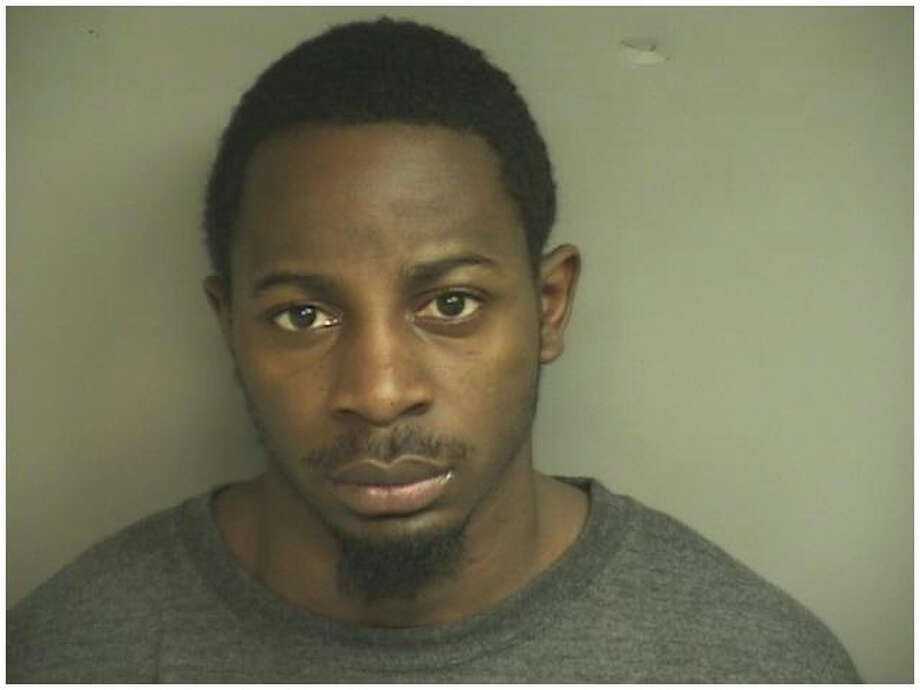 Juan Newman, 26, was charged with first-degree robbery, conspiracy to commit first-degree robbery, first-degree larceny, conspiracy to commit first-degree larceny, third-degree larceny, conspiracy to commit third-degree larceny and resisting arrest.  Newman, who has an extensive criminal record that includes at least one robbery conviction, was additionally charged with first-degree larceny for being in possession of a getaway car that authorities say was stolen from Brooklyn, after police say Newman and three others stole $600,000 worth or Rolexes from the Stamford Town Center mall on Saturday, Nov. 5, 2011. Photo: Stamford Police Department