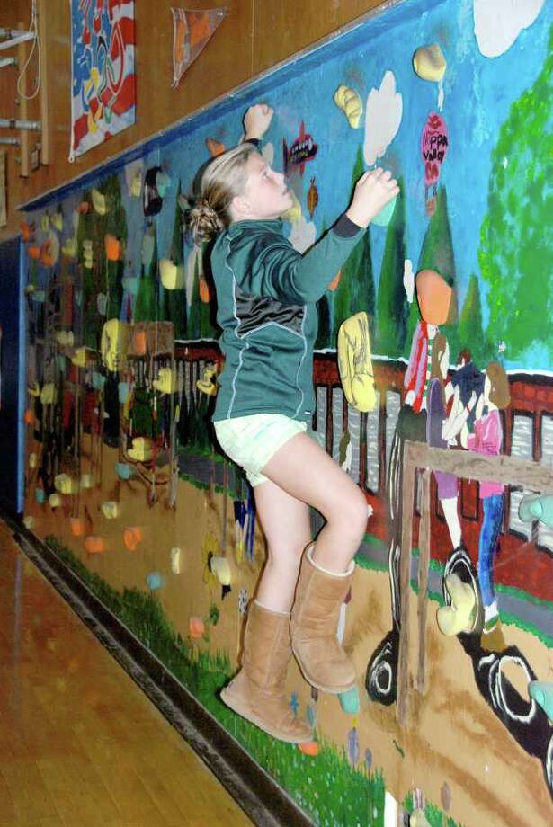 North Street School fifth grader Chelsea Clark ascends a rock wall at NSS Family Health & Nutrition Night, which was held recently. Photo: Contributed Photo