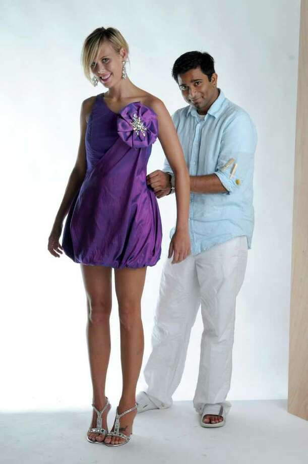 MODEL PERFECT: Designer Zaheer Contractor helps model Brooke Jeffres during a photo shoot for his line ZCREATIONZ.