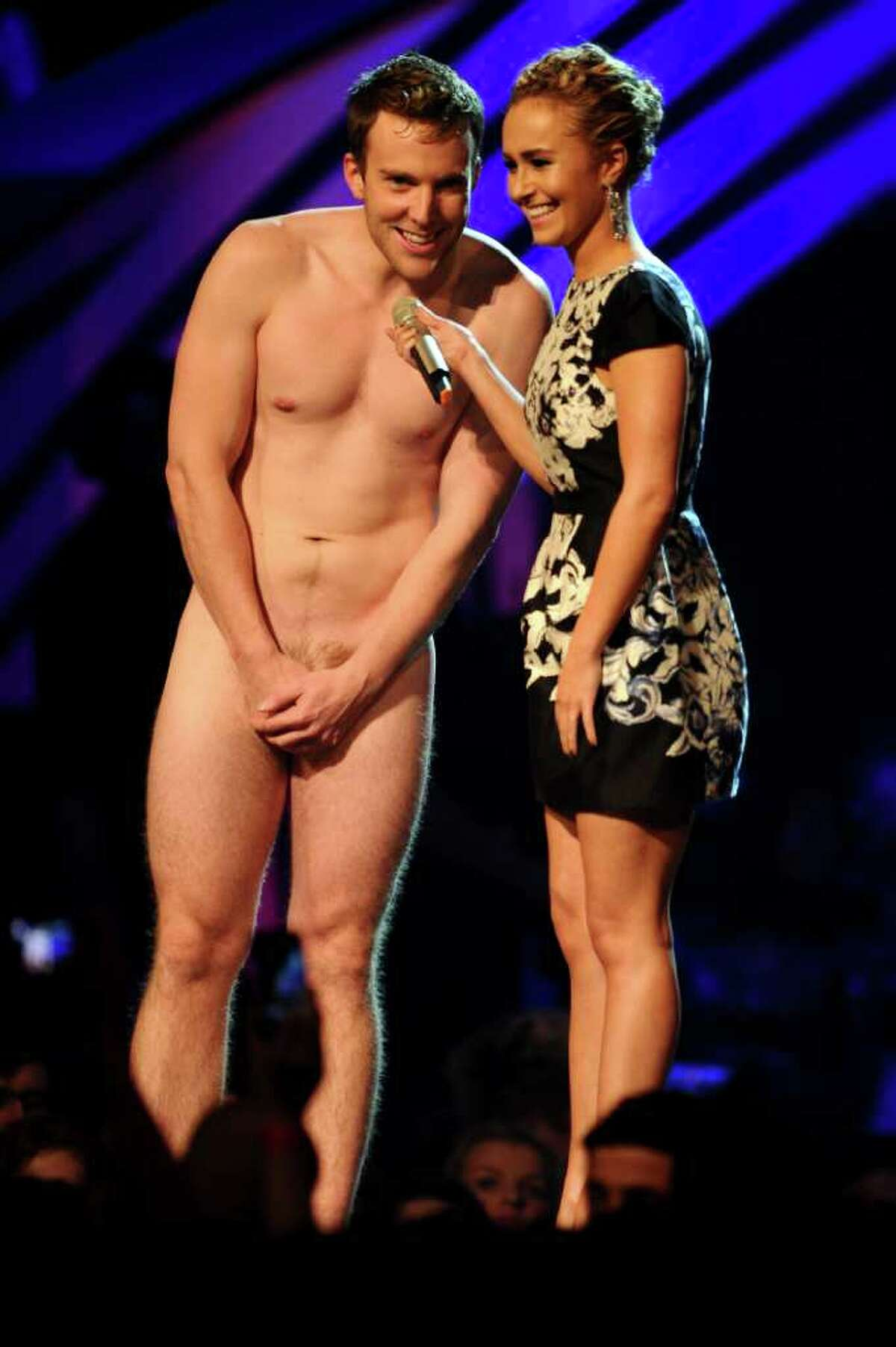 BELFAST, NORTHERN IRELAND - NOVEMBER 06: Actress Hayden Panettiere (R) and naked guest perform onstage during the MTV Europe Music Awards 2011 live show at at the Odyssey Arena on November 6, 2011 in Belfast, Northern Ireland.