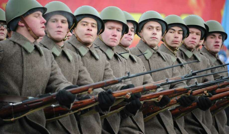 Wearing WWII-era Soviet military uniform Russian soldiers carry the Mosin rifles of the period as they march at the Red Square in Moscow, on November 7, 2011, during a military parade to mark  the 70th anniversary of the 1941 parade, when Red Army troops marched past the Kremlin and then went directly to the front line to fight the Nazi Germany troops at the gates of the Russian capital. Photo: ALEXANDER NEMENOV, Getty / AFP