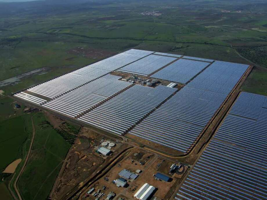GE Energy Financial Services is investing with German fund KGAL in a concentrated solar power plant using molten salt energy storage, shown here, in Badajoz, Spain. Photo: Contributed Photo / Stamford Advocate Contributed