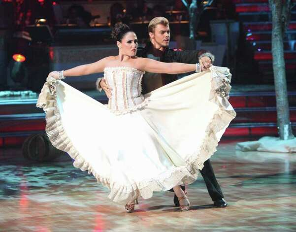 "ABC PHOTOS INTENSE: Ricki Lake and Derek Hough light up the dance floor as one of the remaining couples vying for the mirror ball trophy on Dancing With the Stars. ""I feel like I'm grasping the brass ring,"" Lake says. Photo: (ABC/ADAM TAYLOR), ABC / © 2011 American Broadcasting Companies, Inc. All rights reserved."