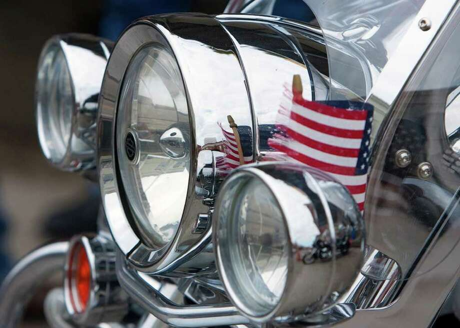 An American flag waves as it sits on a motorcycle during the Lone Star Rally Sunday, Nov. 6, 2011, in Galveston. Photo: Cody Duty, Houston Chronicle / © 2011 Houston Chronicle