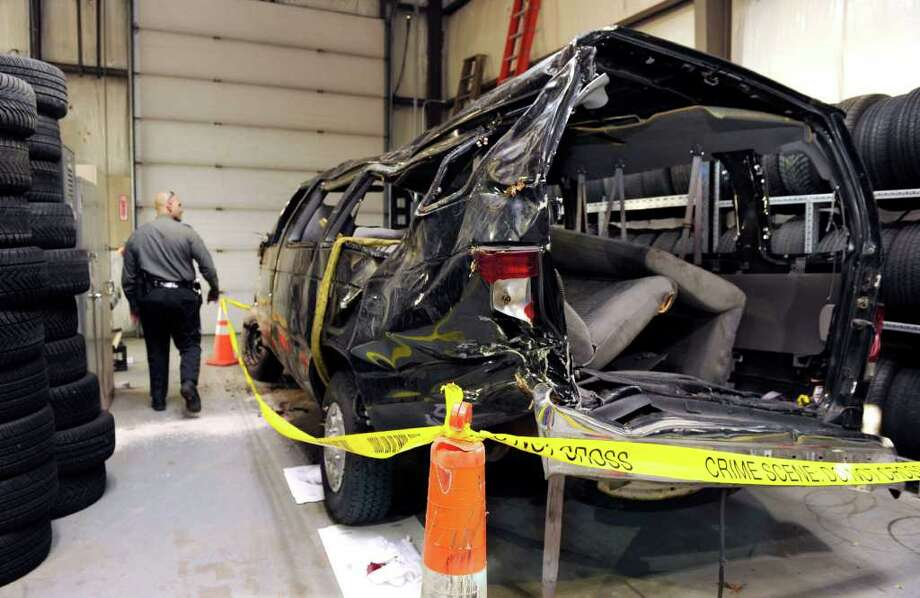 A van that was involved in a fatal accident early Monday morning on I-84 in Danbury sits in a garage at the State Police Troop A barracks in Southbury Monday. Photo taken Monday, Nov. 7, 2011. Photo: Carol Kaliff